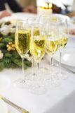Champagne into a glasses standing on the Christmas table Stock Photography