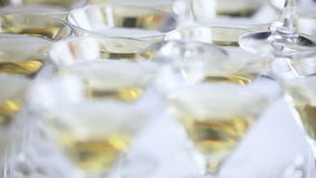Champagne glasses. Standing at desk with champagne glasses. Two scenes stock video footage