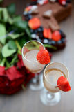 Champagne Glasses with Strawberries and Bunch of Flowers Royalty Free Stock Image