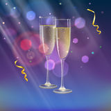 Champagne glasses and streamer with rays of light on background. Glasses of champagne and streamer with rays of light on background. Champagne with bubbles in a Royalty Free Stock Images