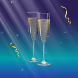 Champagne glasses and streamer with rays of light on background. Glasses of champagne and streamer with rays of light on background. Champagne with bubbles in a Stock Photos