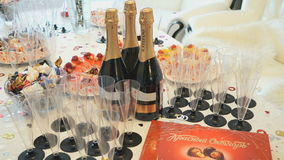 Champagne glasses, sweet candies and bottles stock footage
