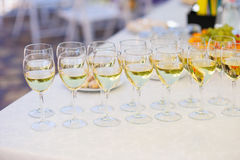 Champagne glasses on the table for the wedding buffet Stock Image