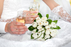 Champagne glasses in their hands Royalty Free Stock Photos