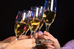 Champagne glasses during toast Royalty Free Stock Image