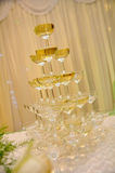 Champagne glasses tower Stock Photos