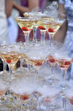 Champagne glasses tower Stock Images