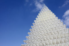 Champagne glasses tower. Against clear blue sky Stock Photo