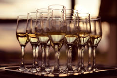 Champagne glasses. Tray with champagne glasses, half full Stock Photography