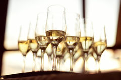 Champagne glasses. Tray with champagne glasses, half full Royalty Free Stock Images