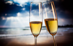 Champagne glasses on tropical beach - exotic New Year Royalty Free Stock Photography