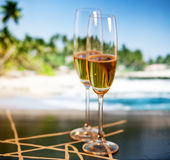 Champagne glasses on tropical beach - exotic New Year Royalty Free Stock Photos