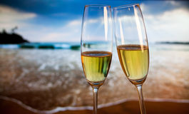 Champagne glasses on tropical beach - exotic New Year Stock Photos
