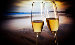 Champagne glasses on tropical beach - exotic New Year Royalty Free Stock Images