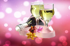 Champagne Glasses. Two champagne glasses and bottle on a glittering background Royalty Free Stock Photos