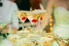 Champagne glasses. Wedding slide champagne for bride and groom. Colorful wedding glasses with champagne. Catering service. Caterin Stock Photo