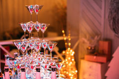 Champagne glasses. Wedding slide champagne for bride and groom. Colorful wedding glasses with champagne. Catering service. Caterin Stock Image