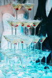 Champagne glasses. Wedding slide champagne for bride and groom. Colorful wedding glasses with champagne. Catering service. Caterin Stock Images