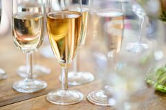 Champagne glasses on wooden table. Selective focus and shallow depth of field Stock Images