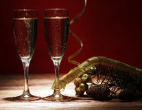 Champagne glasses on wooden table Royalty Free Stock Images