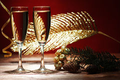 Champagne glasses on wooden table Stock Image