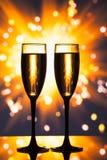 Champagne glassess against sparkler background Stock Photo