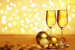 Champagne and golden Christmas ornaments. With blur light on background, for Christmas party concept stock photo