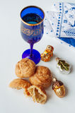 Champagne and gougere. Champagne glass with cheesy gougere Royalty Free Stock Photography