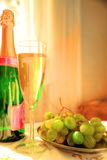 Champagne and grapes Royalty Free Stock Photography