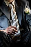 Champagne for groom in the limousine Stock Photos