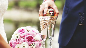 Champagne. Groom pours champagne glasses clink glasses and the newlyweds, FullHD stock video footage