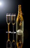Champagne. Holiday champagne bottle and two champagne glass Royalty Free Stock Photography