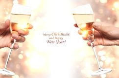 Champagne in honor of the new year and Christmas. Royalty Free Stock Photos