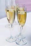 Champagne i exponeringsglas Arkivfoto