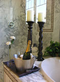 Champagne on Ice. And flower by the bathtub royalty free stock photography