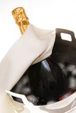 Champagne on ice. Champagne wrapped in white silk in silver ice bucket Royalty Free Stock Image