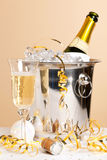 Champagne ice bucket and crystal glass Royalty Free Stock Photography