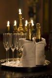 Champagne in kaarslicht Stock Afbeeldingen