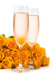 Champagne and a large bouquet of roses Stock Images
