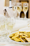 Champagne with light snack serving on wecome Royalty Free Stock Photo