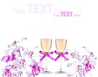 Champagne and lilies Stock Images