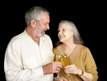 Champagne Love & Laughter. A beautiful senior couple celebrating their anniversary with champagne, love & laughter stock photos