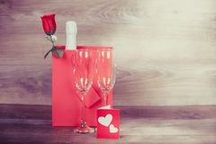 Champagne and love message. Valentines Day. Champagne in a paper bag, wine glasses and love message. Appointment, Birthday. Concept: happiness, holiday Royalty Free Stock Photo