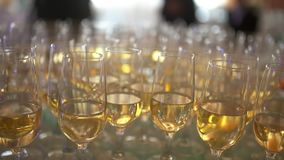 New Year Champagne Flutes. Champagne. many champagne Flutes with Sparkling Champagne over new year party Background stock footage