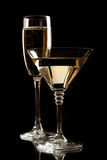 Champagne and martini glasses isolated on black Royalty Free Stock Photo