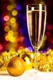 Champagne med jultoys Royaltyfria Foton