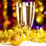 Champagne med jultoys Fotografering för Bildbyråer