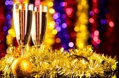 Champagne med jultoys Royaltyfri Foto