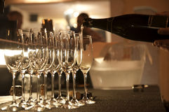 Champagne moment. Wine glasses and champagne bottle Royalty Free Stock Image