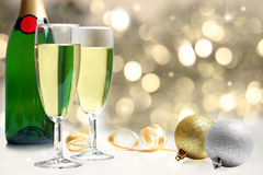 Champagne near Christmas decorations Stock Photography